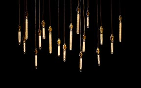 Our New Pendant Clusters - British Brass Lampholders on braided fabric cords with vintage bulbs.